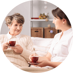 caregiver and senior talking